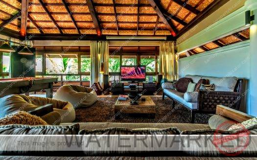 Lounge area with large sofas and majestic chairs, beanbags at Satori Bali Villa Koh Samui